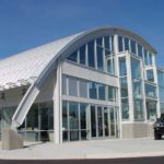 Intricately designed modern curved roof on a modern looking building