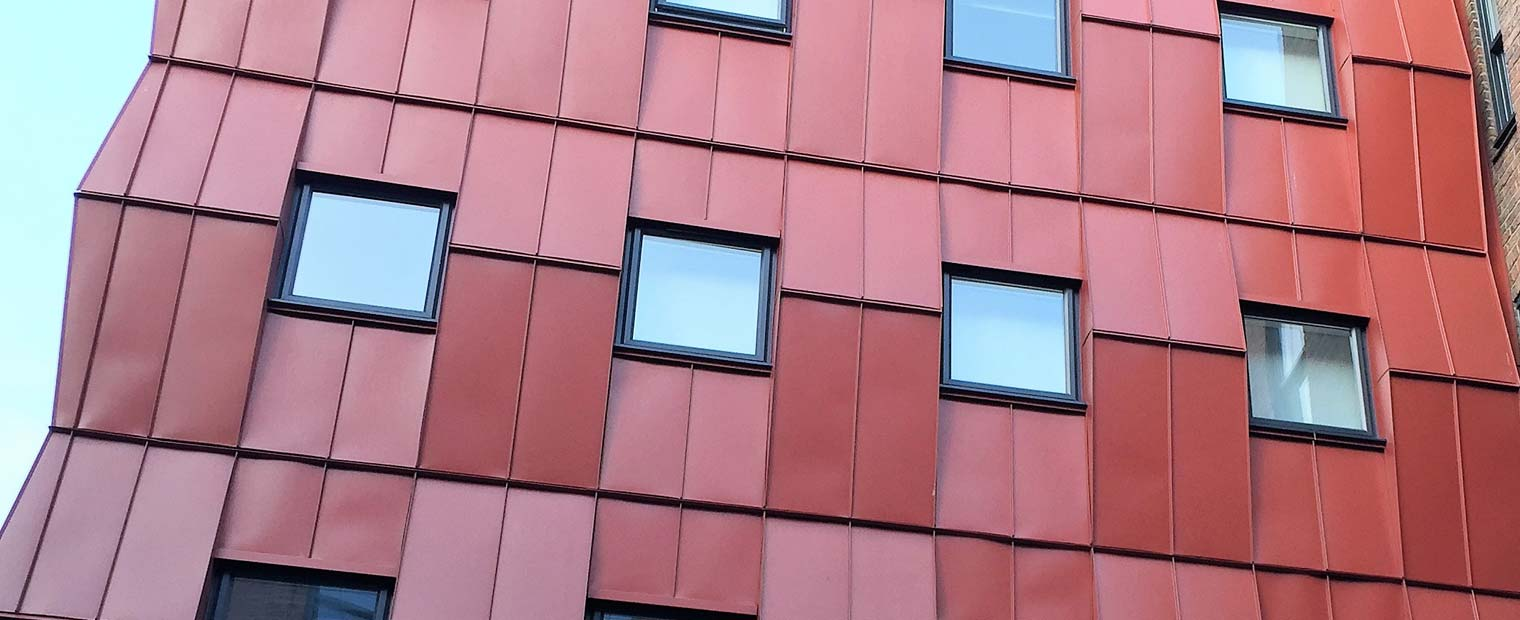 Bespoke Red Angular Cladding on an Office Building