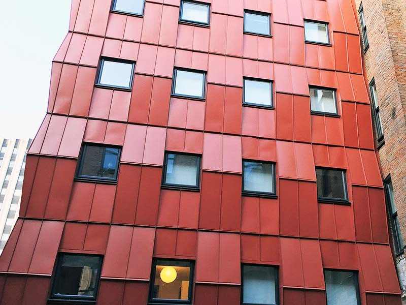 patterned red clad wall on industrial building