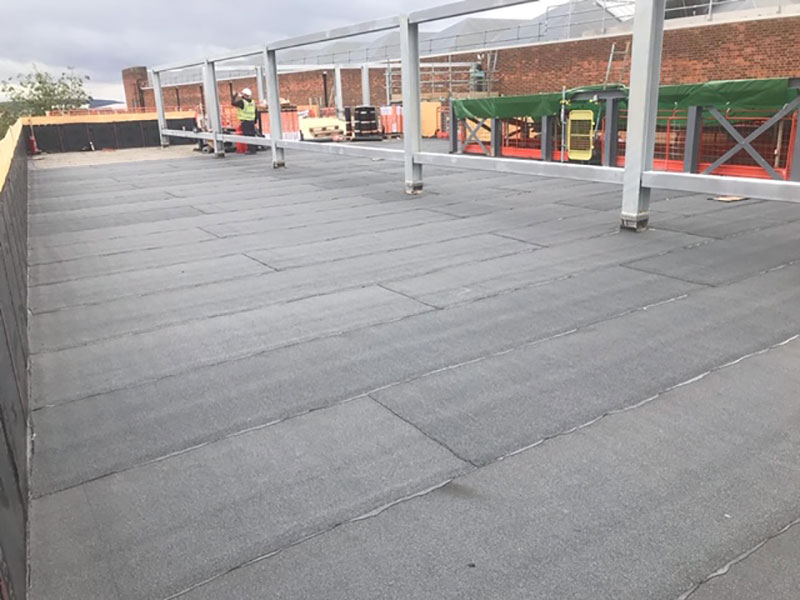 wellwood flat roofing solution using roofing felt and heat torches