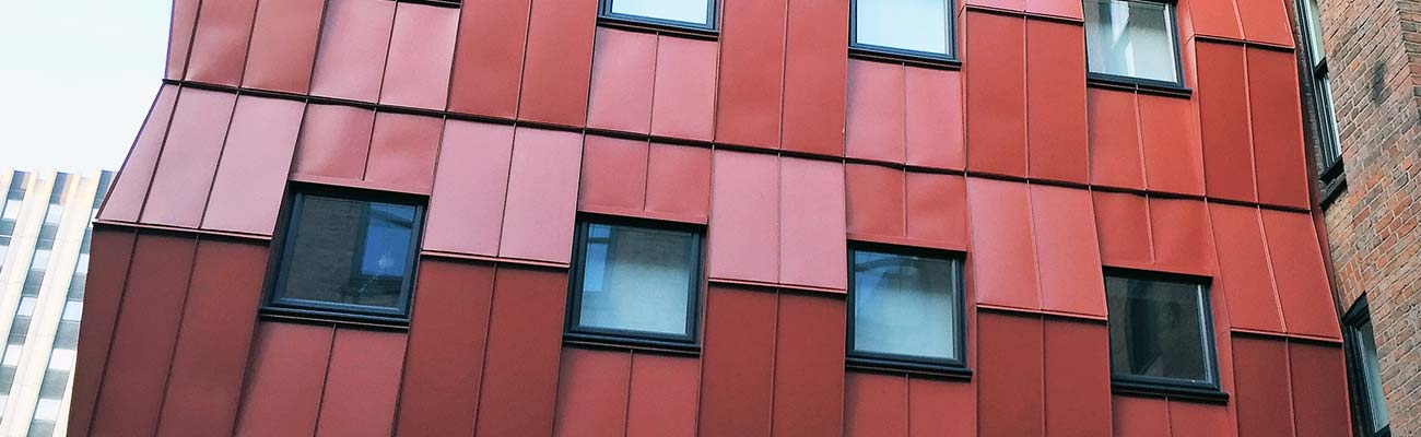 Terracotta rain screen cladding hero image on student accommodation in Leicester